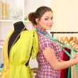 Beautiful young dressmaker in workroom — Stock Photo #22798032