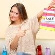 Woman with bags in shopping mall — Stock Photo #22798034