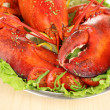 Stock Photo: Red lobster on platter with vegetables on wooden table close-up