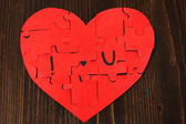 Puzzles in form of heart with words I love u — Stock Photo