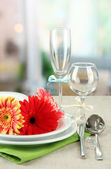 Table serving on bright background — Stock Photo