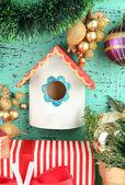 Nesting box and Christmas decoration on blue background — Stock Photo