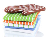 Brown potholder and stack of kitchen towels isolated on white — Stock Photo