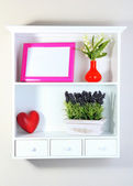 Beautiful white shelves with different home related objects — Stock Photo