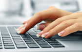 Female hands typing on laptot, close-up — Stock Photo