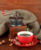 Dark chocolate, hot drink and coffee mill on wooden background — Stock Photo