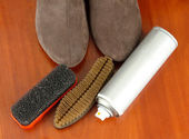 Set of stuff for cleaning and polish shoes, on wooden background — Stock Photo