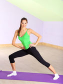 Young woman doing fitness exercises at gym — Stock Photo