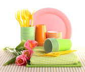 Multicolored plastic tableware isolated on white — Stock Photo