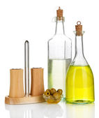 Original glass bottles with salad dressing isolated on white — Stock Photo