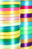 Bright ribbons on pink background — Stock Photo