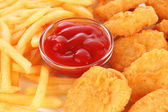 Fried chicken nuggets with french fries and sauce isolated on white — Stock Photo