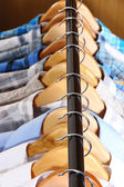 Men's shirts on hangers in wardrobe — Stock Photo