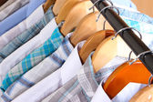 Men's shirts on hangers close-up — Stock Photo