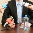 Stock Photo: Conference meeting microphone with businessmor politician
