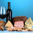 Exquisite still life of wine, cheese and meat products — Stock Photo #22904880