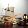 Golden scales of justice, gavel and books on grey background — Stock Photo #22908240