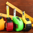 Tape measure and ruler on wooden background — Foto de Stock