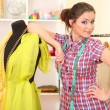 Beautiful young dressmaker in workroom — Stock Photo #22909410