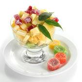Fruit salad in a sundae dish isolated on white — Stock Photo
