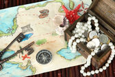 Map of treasures on dark wooden background — Stock Photo