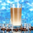 Cold coffee with ice in glass on blue background — Stock Photo #22919936