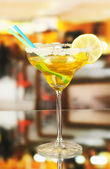 Yellow cocktail in glass on room background — Stock Photo