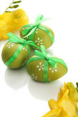Bright easter eggs with bow and flowers, isolated on white — Zdjęcie stockowe