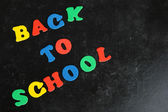 Back to school message written in colorful letters on school board close-up — Stock Photo