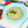 Stock Photo: Diet soup with vegetables in pan on wooden table close-up
