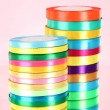 Bright ribbons on pink background — Stockfoto