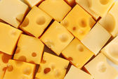 Cheese cubes background — Stock Photo
