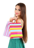 молодая красивая девушка в зеленом платье, холдинг яркие сумки, изолированные на белом — Стоковое фото
