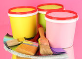 Set for painting: paint pots, brushes, palette of colors on pink background — Stock Photo