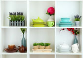 Beautiful white shelves with tableware and deco — Stok fotoğraf