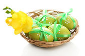Bright easter eggs with bows in basket, isolated on white — Стоковое фото