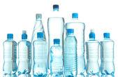 Verschillende flessen water geïsoleerd op wit — Stockfoto