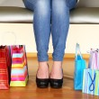 Woman with bags in shopping mall — Stock Photo