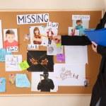 Detective investigating abduction of children — Stock Photo