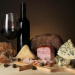 Exquisite still life of wine, cheese and meat products — Stock Photo #22936208