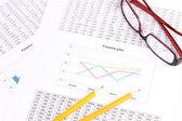 Documents, calculator and glasses close-u — Stock Photo