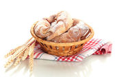 Taste croissants in basket isolated on whit — Stock Photo