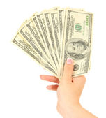 Female hand with dollars, close up, isolated on white — Stock Photo