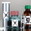 Deadly poison in bottles on grey background — Stock Photo #22942628