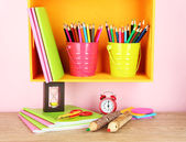 Colorful pencils in pails on shelf on beige background — Stock Photo