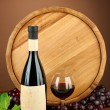 Composition of wine, wooden barrel and grape, on brown background — Stock Photo #22992106