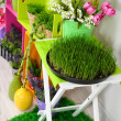 Colorful shelves and table with decorative elements and flowers — Stockfoto