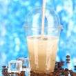 Cold coffee with ice in glass on blue background — Stock Photo #22998658