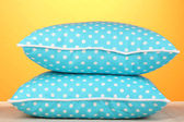Blue bright pillows on orange background — Stock Photo