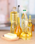 Different types of oil on table in kitchen — Stock Photo